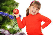 Little girl decorates a fur-tree. — Stock Photo