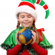 Girl in suit Santa's elf with a Christmas ball. — Stock Photo