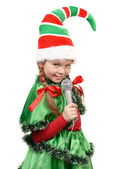 Girl - Santa's elf with a microphone — Stock Photo