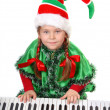 Girl - Santa's elf plays a synthesizer. — Stock Photo