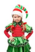 The angry little girl - Santa's elf. — Stock Photo