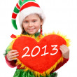 Girl in Christmas elf suit holds heart. — Stock Photo