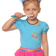 Girl has control over a tooth-brush — Stock Photo #17471081
