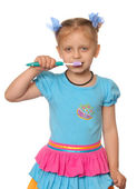 Girl has control over a tooth-brush — Stock Photo