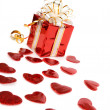Red gift box and hearts isolated on white — Stock Photo