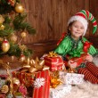 Girl - the Christmas elf with a gift — Stock Photo