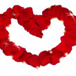 Royalty-Free Stock Photo: Rose petals heart with shining glow of stars. Isolated