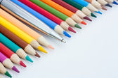 Color pencils and pen — Stock Photo