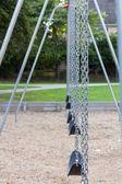 Playground swings — Stock Photo