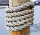 Rope around wood — Stock Photo