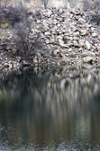 Black water of lake in old quarry  — Stock Photo
