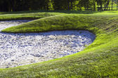 Sand bunkers on the golf course. — Стоковое фото
