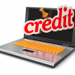 Laptop and credit — Stock Photo
