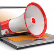 Laptop and Megaphone — Stock Photo