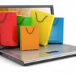Laptop and Shopping Bags — Stock Photo