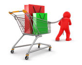 Man pulling shopping cart with shoping bags — Stock Photo