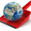 Planet on dustpan — Stock Photo