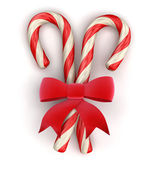 Candy Cane and Celebration Bow — Stock Photo
