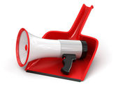 Megaphone on dustpan — Stock fotografie