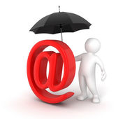 Man under umbrella and e-mail symbol — Стоковое фото