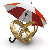 Gold rings under Umbrella — Stock Photo