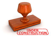 Under construction rubber stamp — Stock Photo