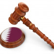 Wooden Mallet and Qatar flag — Stock Photo