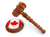 Wooden Mallet and Canada flag — Stock Photo