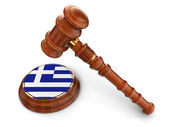 Wooden Mallet and Greek flag — Stock Photo