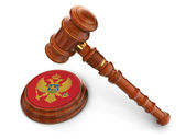 Wooden Mallet and montenegro flag — Stock Photo