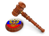 Wooden Mallet and Russian flag — Stock Photo