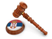 Wooden Mallet and Serbian flag — Stock Photo