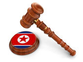 Wooden Mallet and North Korea flag — Stock Photo
