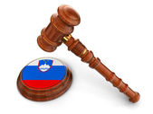 Wooden Mallet and Slovenian flag — Stock Photo