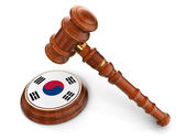 Wooden Mallet and South Korean flag — Stock Photo