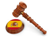 Wooden Mallet and Spanish flag — Stock Photo
