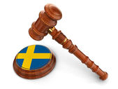 Wooden Mallet and Sweden flag — Stock Photo