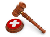 Wooden Mallet and Swiss flag — Stock Photo