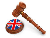 Wooden Mallet and British flag — Stock Photo