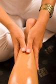 Massaging a thigh — Stockfoto