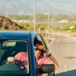 Stock Photo: Phoning while driving