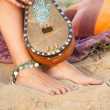 Stock Photo: Bare feet on sand