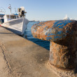 Fishing harbor bollard - Stock Photo
