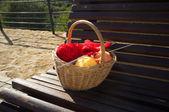 Knitting on park bench — Stock Photo