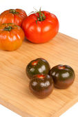 Red and green tomatoes — Stock Photo