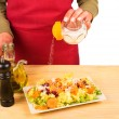 Salting a salad — Stock Photo