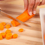 Chopping carrots — Stock Photo