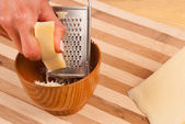 Grating cheese — Stock Photo