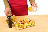 Salting a salad — Stock Photo