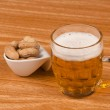 Beer and peanuts — Stock Photo